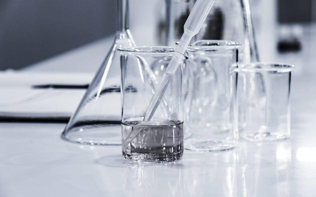 Glass beakers with pipette
