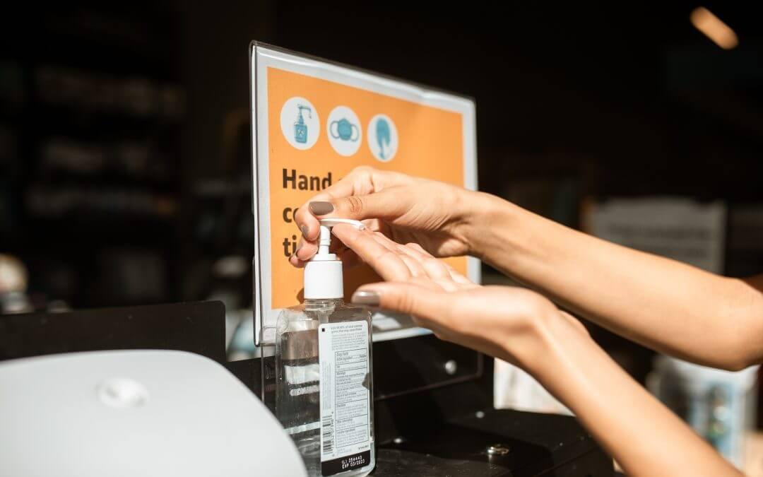 An individual using a hand sanitiser